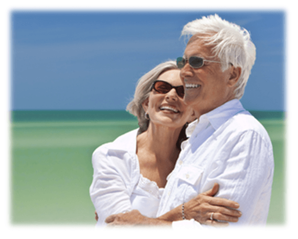 Couple walking on beach - Medicare